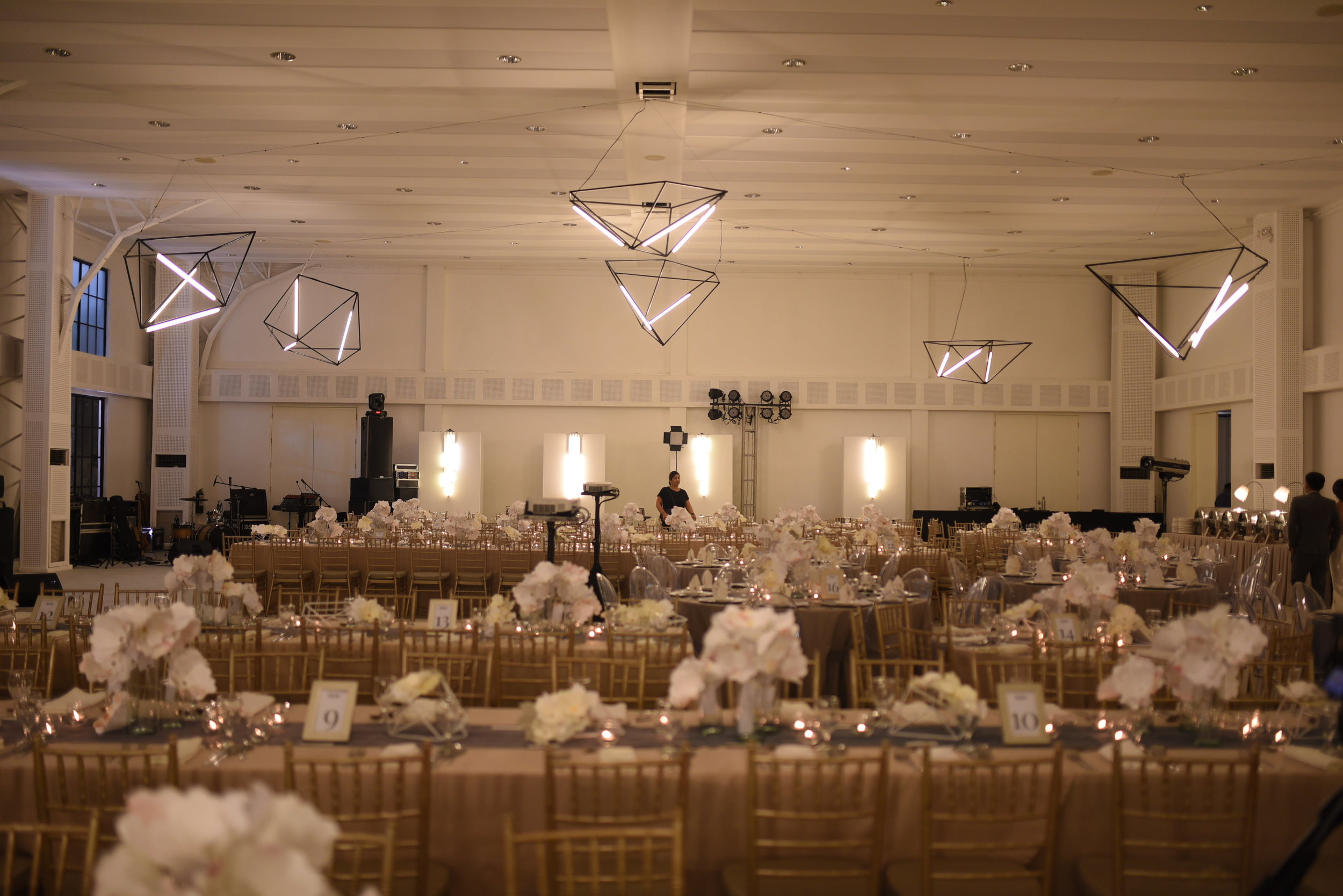 The venue - geometric darkness and paper flowers.