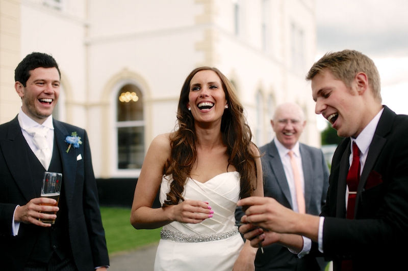 Making the bride and groom laugh.