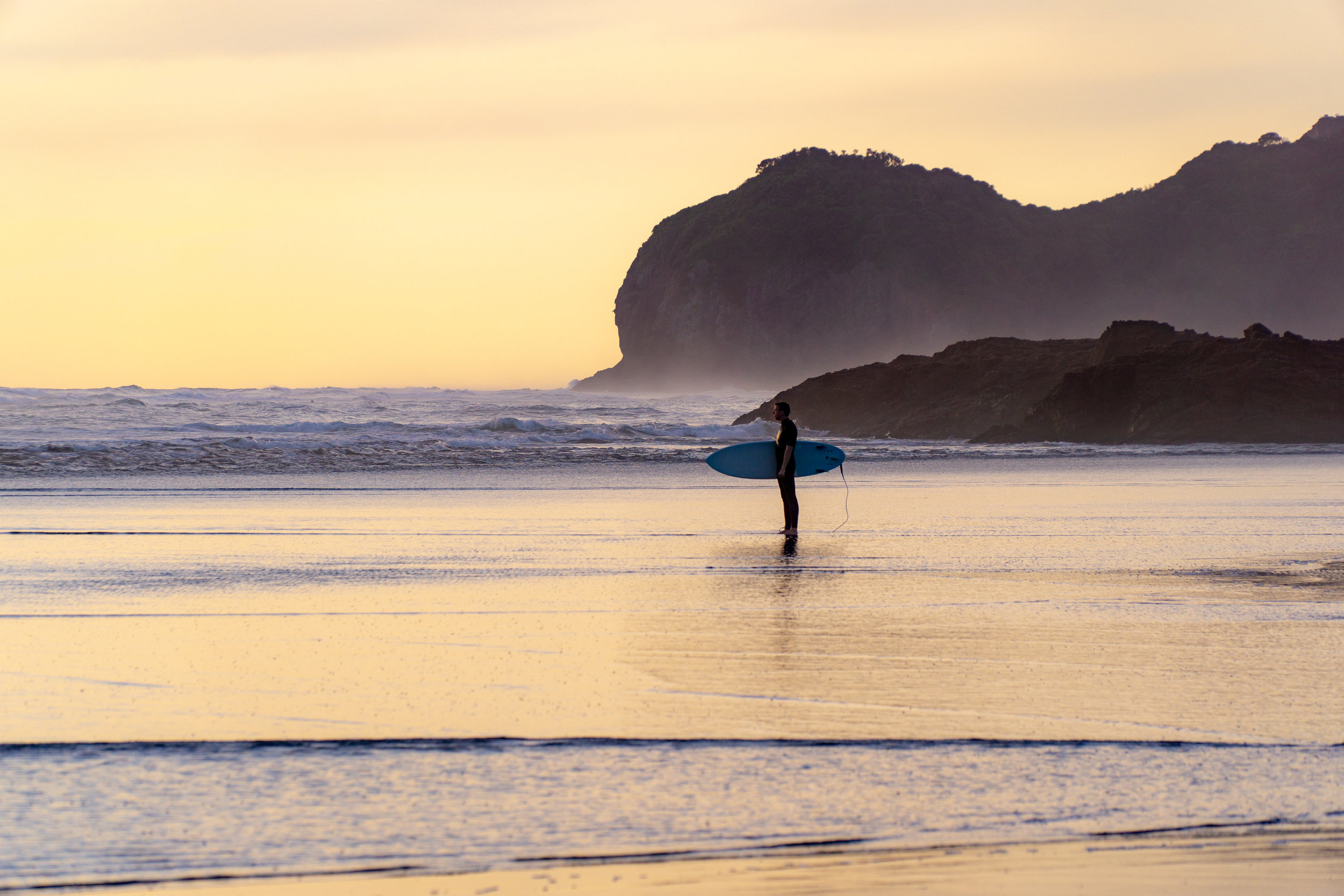 surfer on piha beach