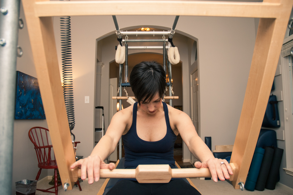 Collette of Collette Pilates at work on the Cadillac.