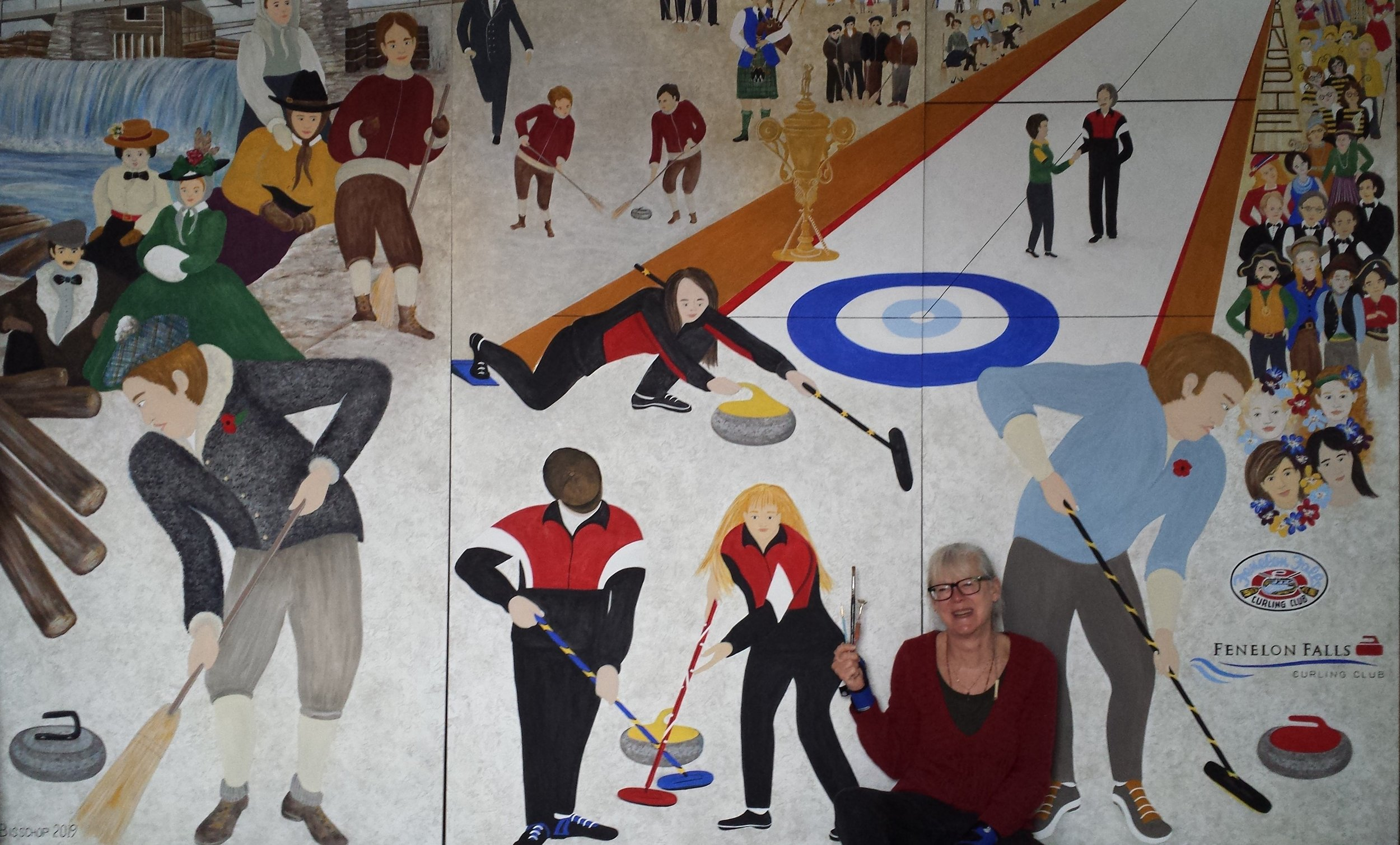 Donna Bisschop with her newly finished mural for the Fenelon Falls Curling Club