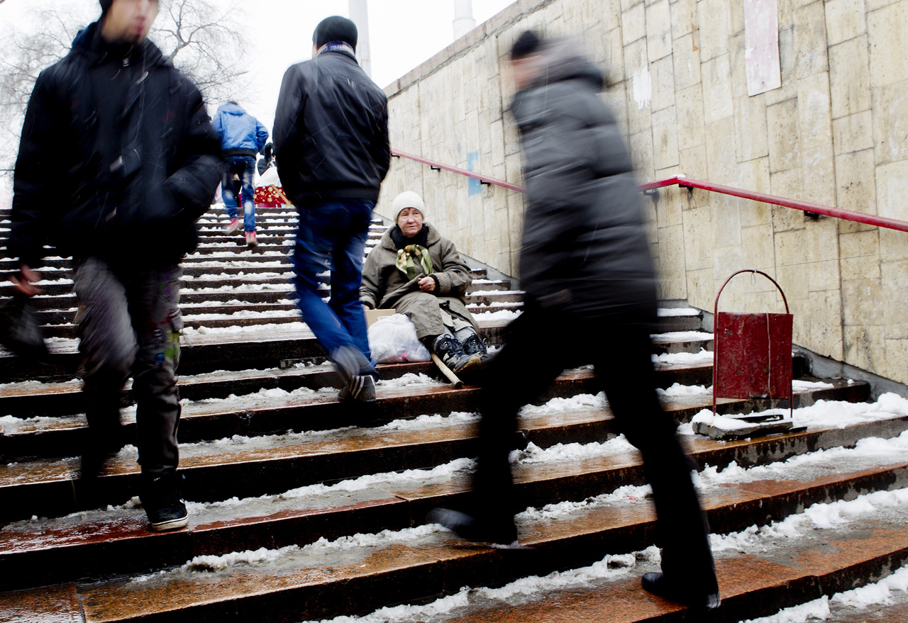 Elena Andreava begs for money on the steps of a Bishkek shopping center.