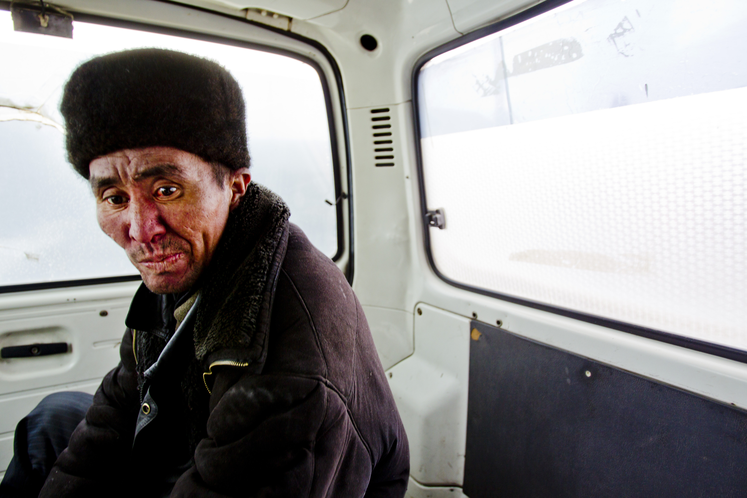 The constant below-freezing temperatures in winter make being homeless deadly. People often live in the sewer system in attempt to stay warm, but after awhile many end up jammed in overcrowded public hospitals because of frostbite, or burns from passing out on the hot sewer pipes or camp fires. Amputation of the toes, feet and fingertips because of frostbite is a common occurrence.  A homeless man rides in an ambulance to Bishkek Hospital Number 4 for frostbite treatment.