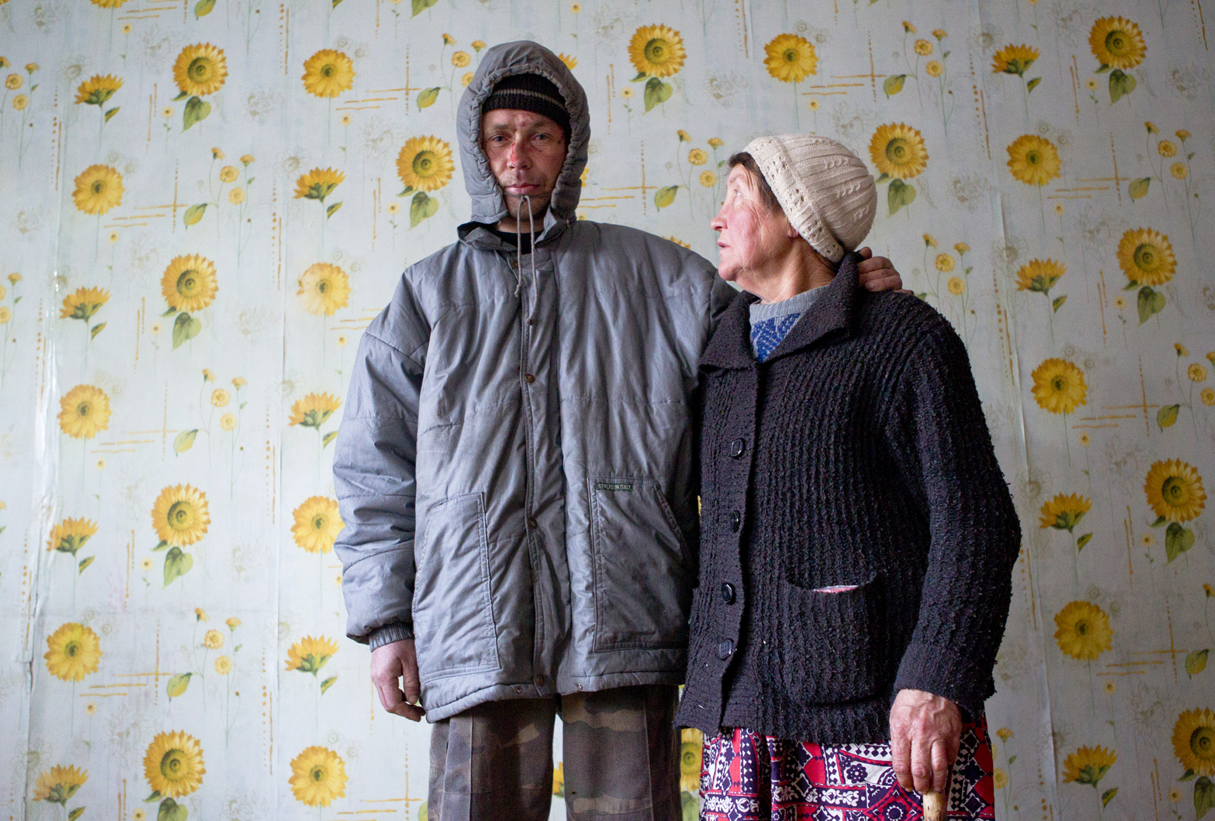 Evgeniy, and his mother, Elena Andreava, wait for food in the dining hall of the Kolotomoto homeless shelter in Bishkek. They have been homeless, battling Bishkek's harsh winters, for over ten years.