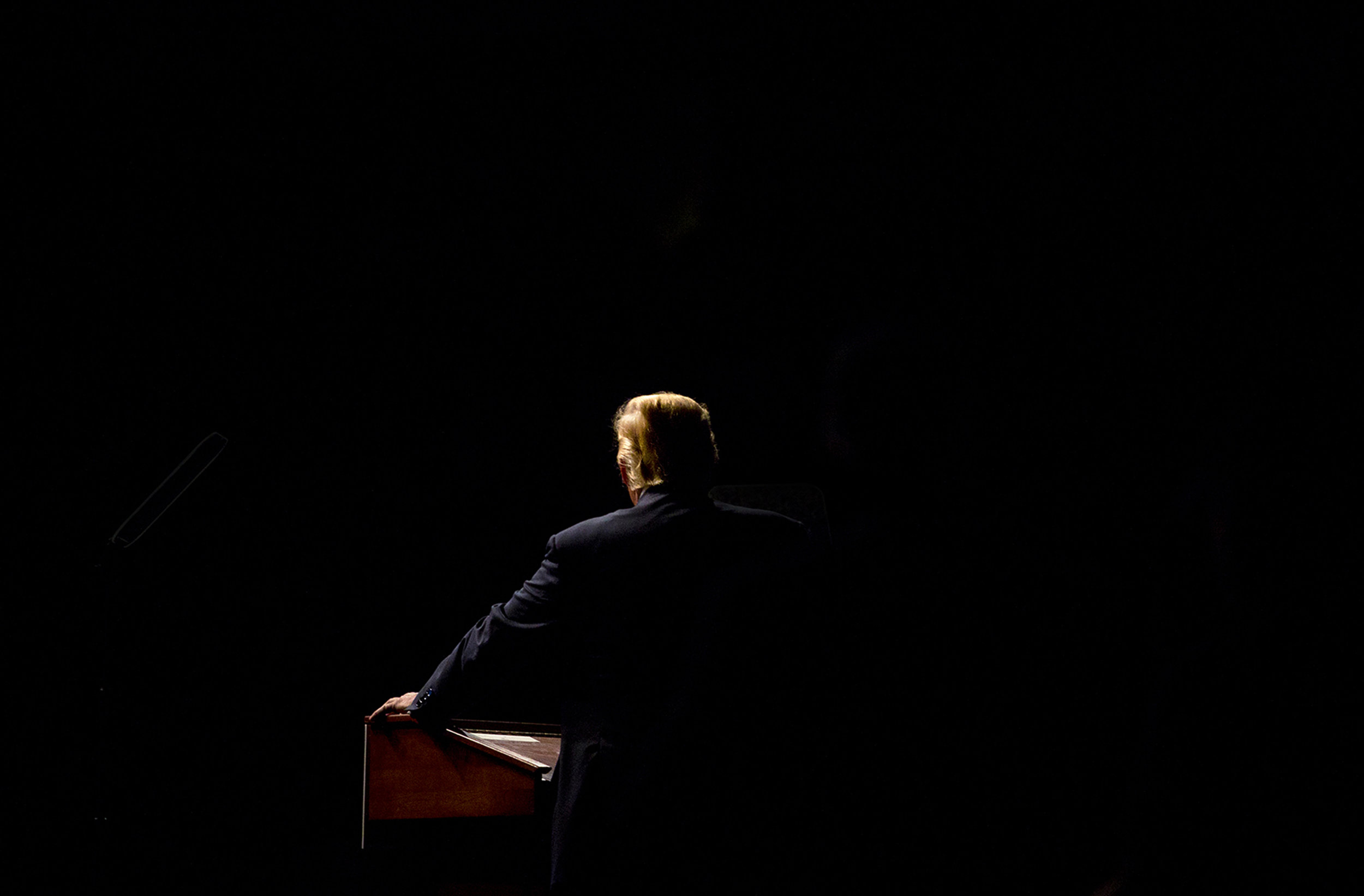 Donald Trump illuminated by bright stage lights at a campaign rally in Bangor, Maine. Trump campaigned hard in the second district of the state and went on the win it in the election, splitting Maine's electoral votes for the first time in state history.