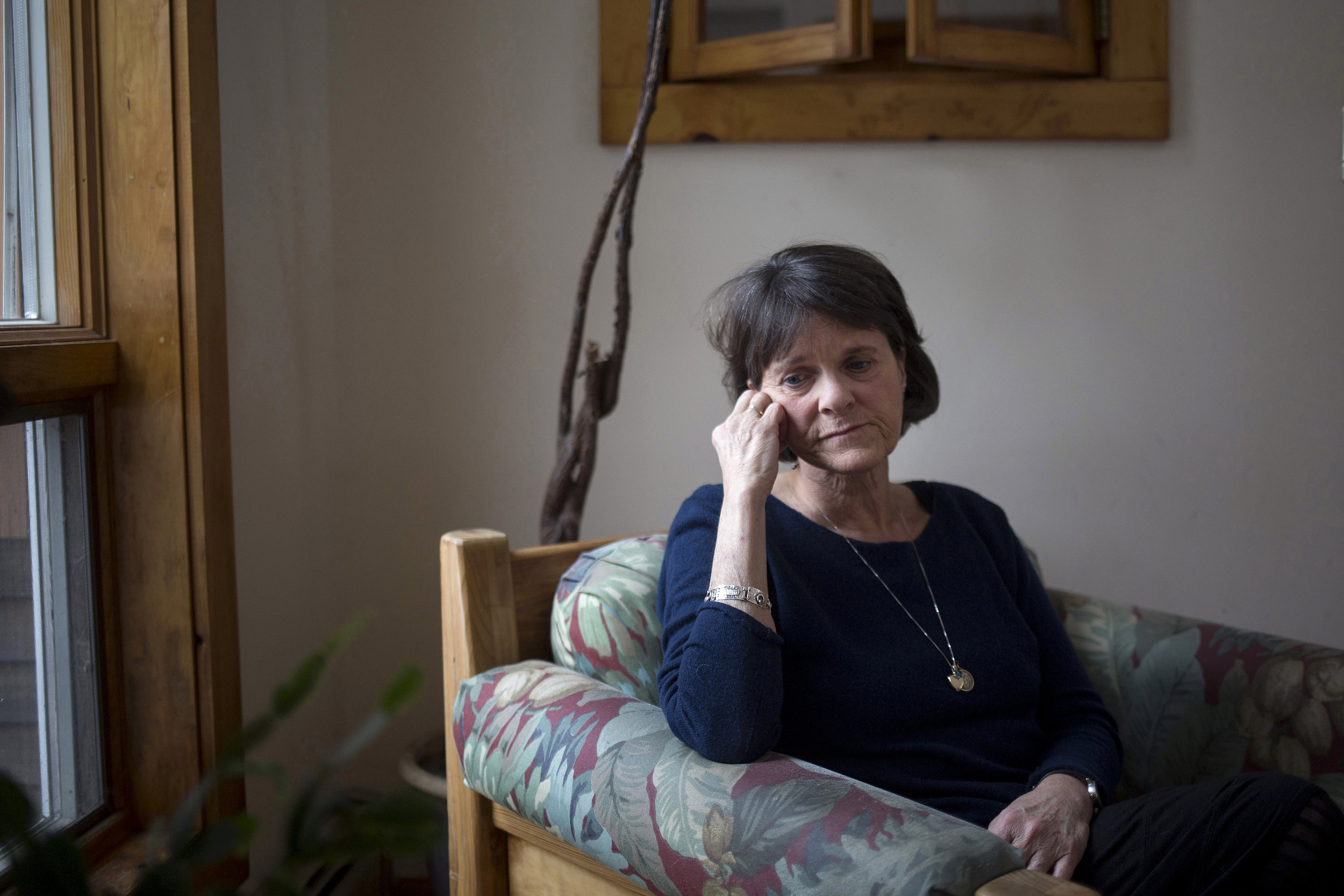 Lynn Ouellette at her home in Brunswick, Maine. She wears some of her son Brendan Keating's ashes in a heart-shaped locket around her neck every day. Brendan died from an overdose on Dec. 16, 2013. He was 22 years old.