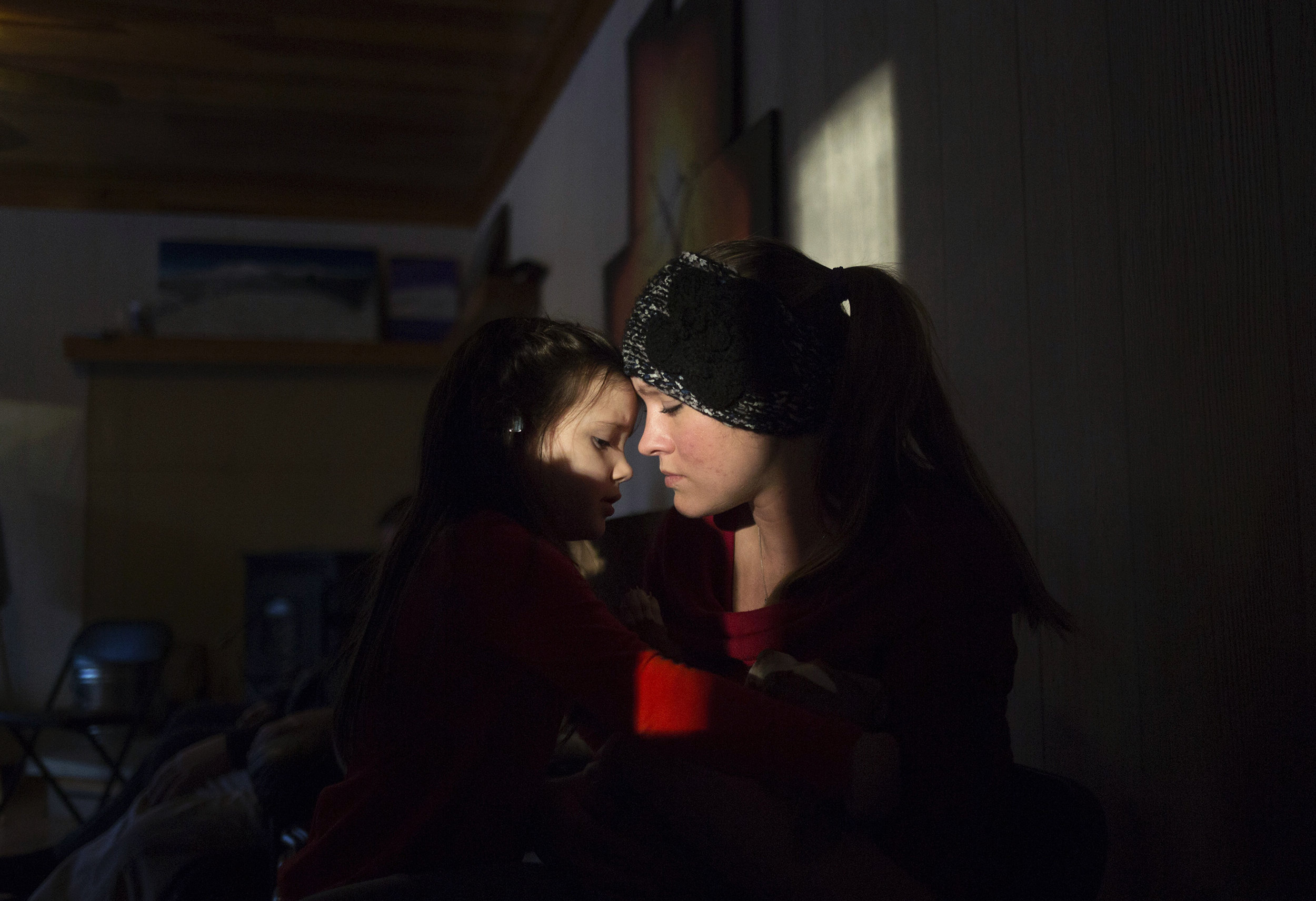 Shannon Long talks with her 4-year-old daughter, Hope, after having lunch with her extended family in West Paris, Maine. Long is six months into recovery from an addiction to heroin and opioids. She started abusing pills as a teenager in her rural Maine town.