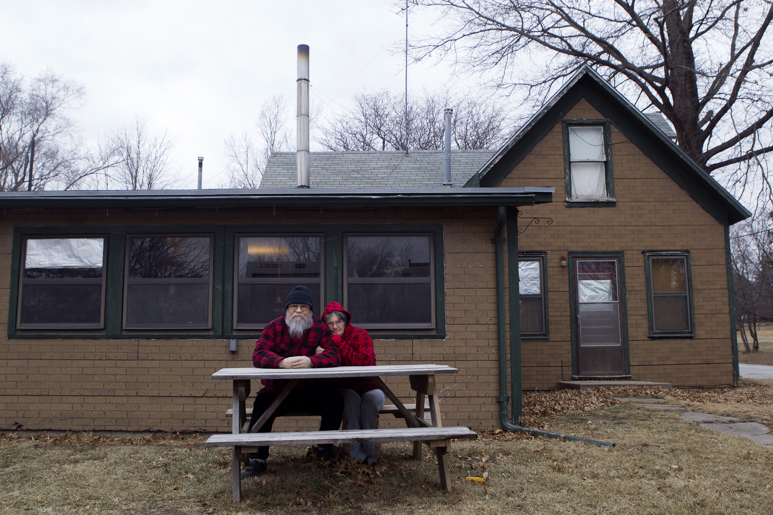 Steve and Sandy Syslo outside of their home in Douglas, Nebraska.