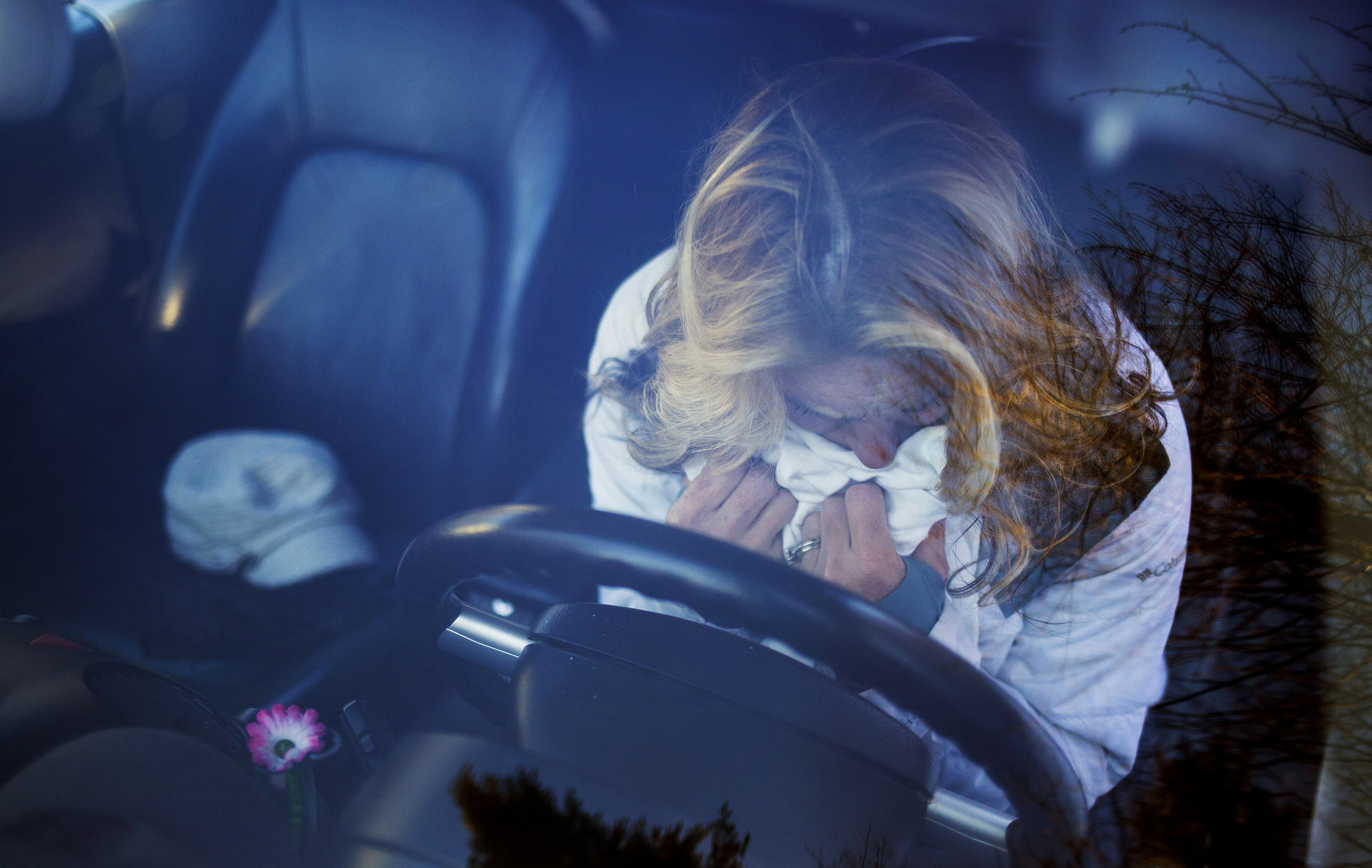 Ann Howgate buries her face in the blanket that the police covered her daughter's body up with when the discovered her dead in her car from an overdose. Kristina Emard died on Sept. 25, 2016. She was 28 years old.