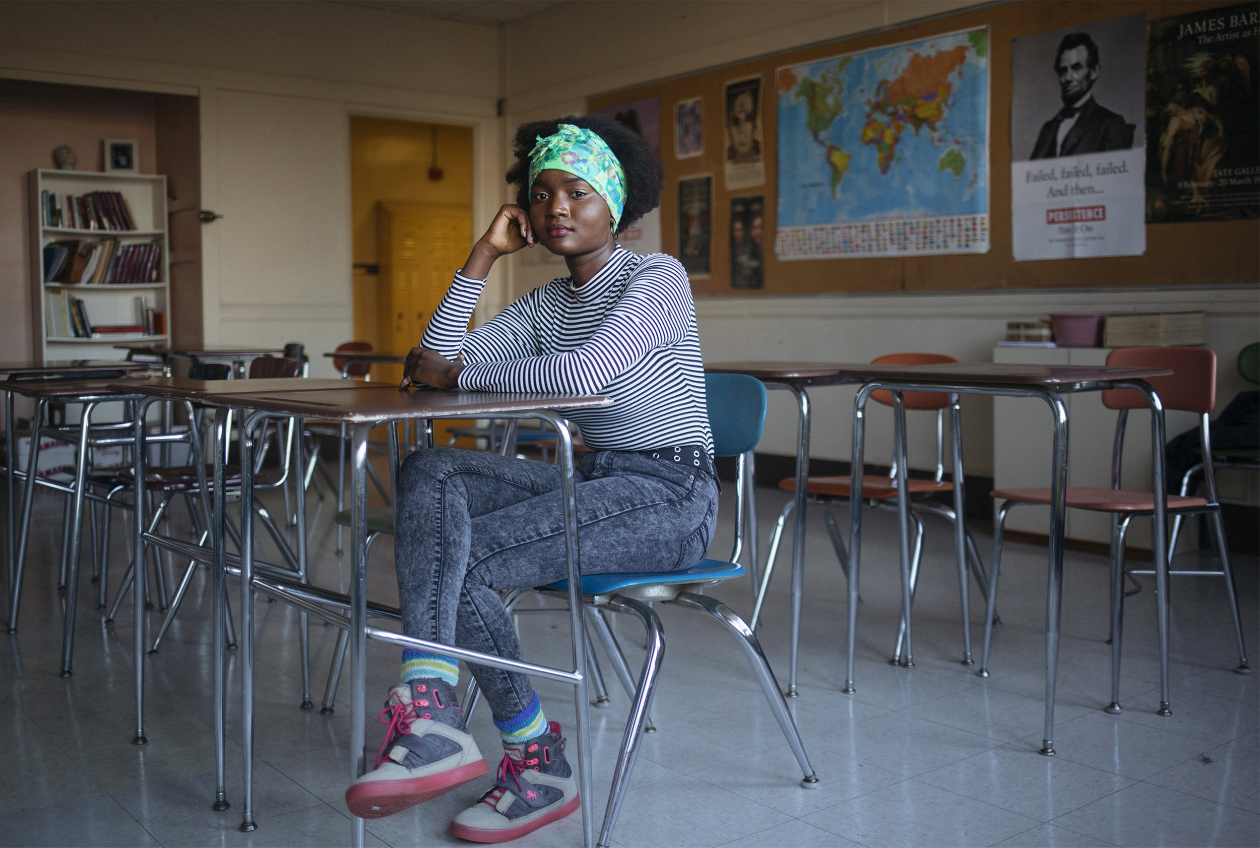 Brenda Viola in a classroom at Deering High School in Portland, Maine where she is senior. The 17-year-old Viola came to the U.S. at from a refugee camp in Kenya when she was 12 and now volunteers to help new immigrant students acclimate.