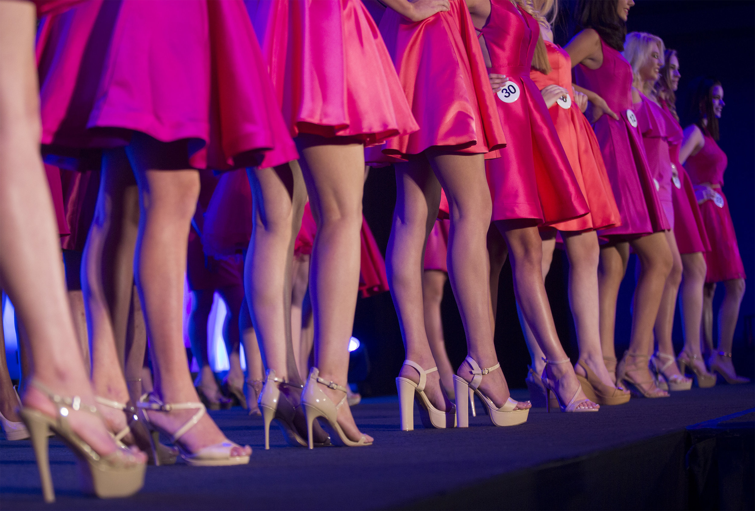 Miss Maine Teen USA contestants lined up on stage during judging.