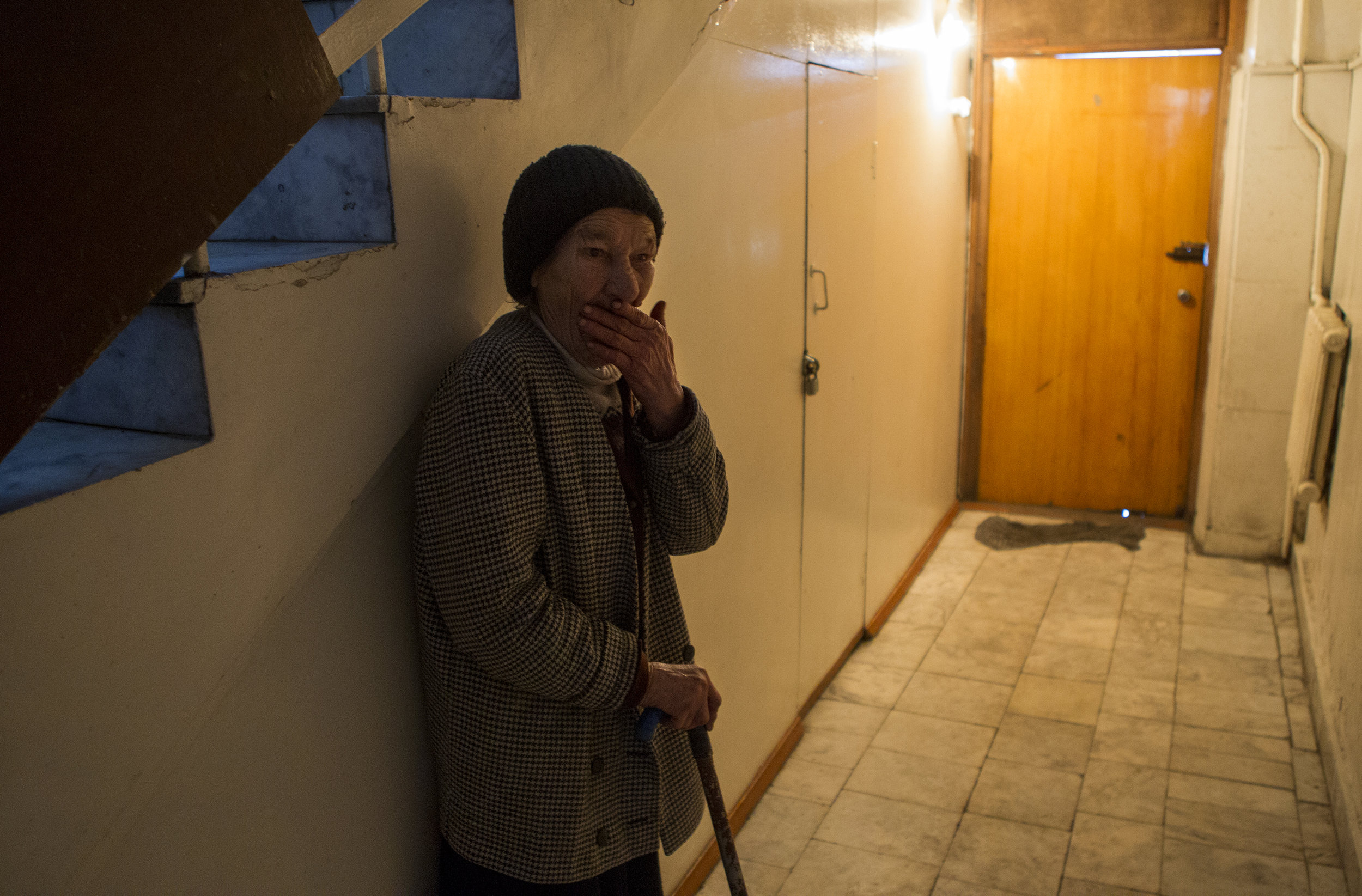 Tatiana Gerasimova, a blind homeless woman, stands in the hallway after lunch at the Kolotomto shelter in Bishkek. The Kolotomto shelter is one of the few places that the homeless can go for help in Bishkek.