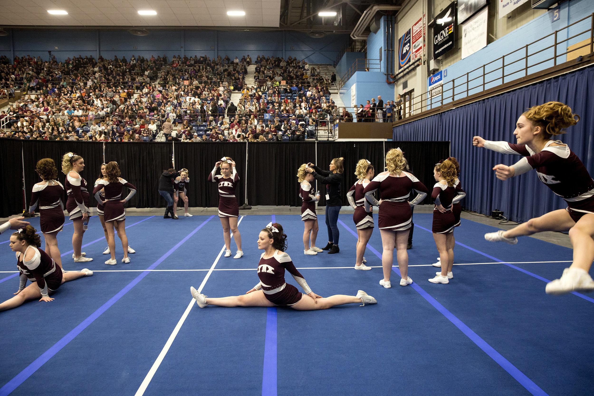 Mattanawcook Academy cheerleaders practice at the State Cheerleading Championships in Augusta, Maine.