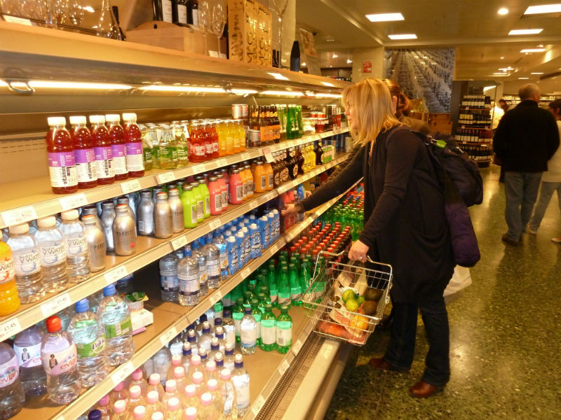 shopper choosing drinks in store