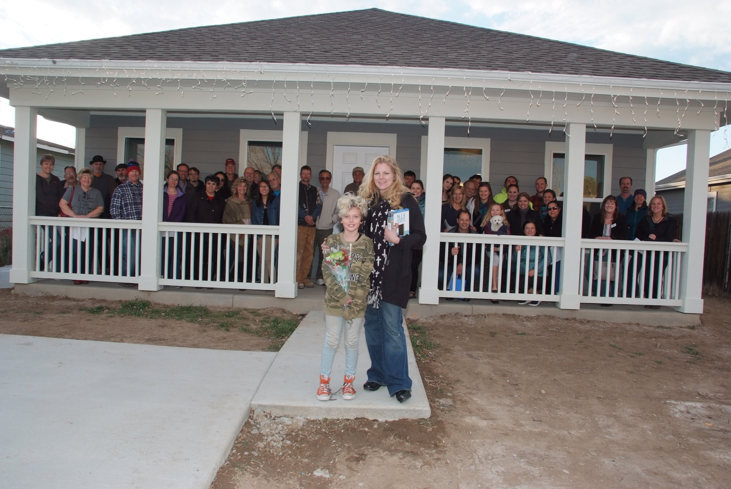 """12/28/18 - Last Friday evening, St. Vrain Habitat celebrated a home dedication  with family, friends, neighbors, volunteers, staff, board, and supporters. It truly was Christmas """"magical,"""" complete with carols, cocoa, and cookies. Congratulations Ericksons! Welcome to your new home!"""