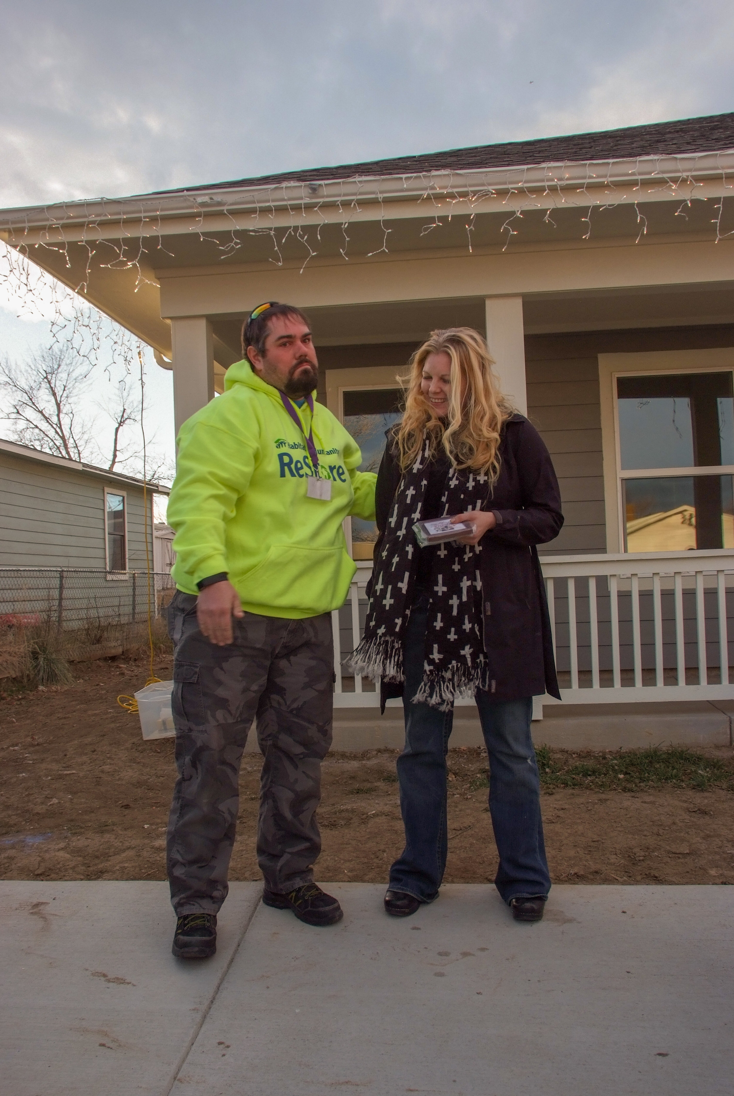 """12/28/19 - Tim has been volunteering with St. Vrain ReStore for over ten years.  Last Friday, he presented the ReStore gift card to the new Habitat homeowner at the dedication. Tim got to know the Ericksons via their """"sweat equity"""" time at the ReStore. Thank you, Tim, for your years of service and for your commitment to Habitat!"""