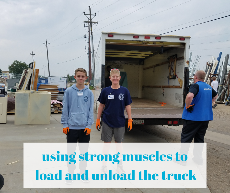 using strong muscles to load and unload the truck.png