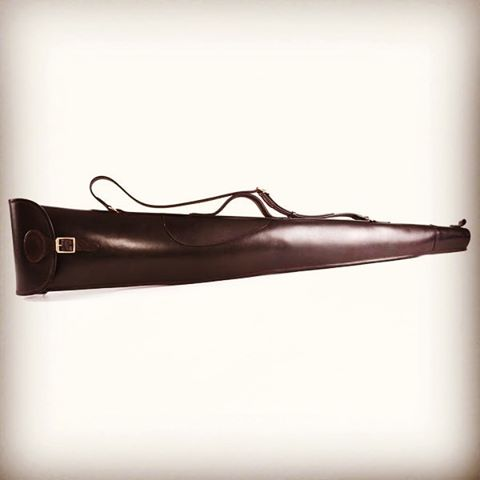 """LEATHER FLAP & ZIP GUN SLIP. Flap & zip leather gun slip with full length zip, flap and buckle for extra security.  Available in 50"""" and 52"""" length options (for up to 30"""" and 32"""" barrels). Montrose flock lining.  Sold brass buckle.  Saddle leather shoulder strap and padded leather carrying handle.  Dark Havana leather.  Double stitched blocked end to protect gun barrels. #mensaccessories #mensgoods #love #mensstyle #instagood #style #british #present #britishmade #fashion #fashionblogger #gentlemen #winter #bespoke #luxury #womens #menswear #womenswear #handmade #uk #shooting #countryside #sport #seasons  #gunslip #handmade #leather"""
