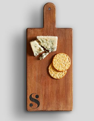 Pottery Barn carries  this  adorable personalized cheese board & it's under $30!