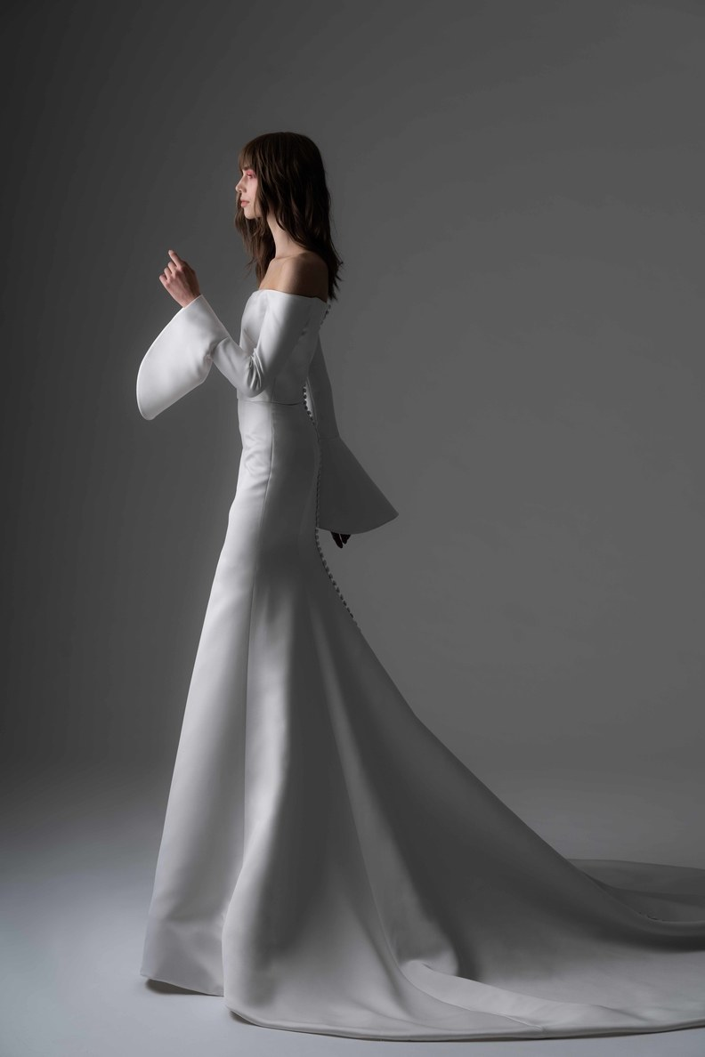 This dress designed by Rivini by Rita Vinieris is everything. Nothing makes a statement like a gown with sleeves. .