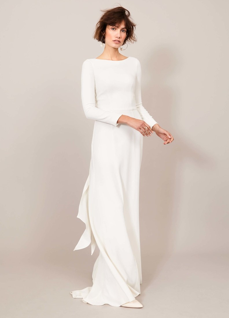 We are loving this wedding dress by Kaviar Gauche. The simplistic cute and flow gives this dress and effortless look. And again, sleeves.