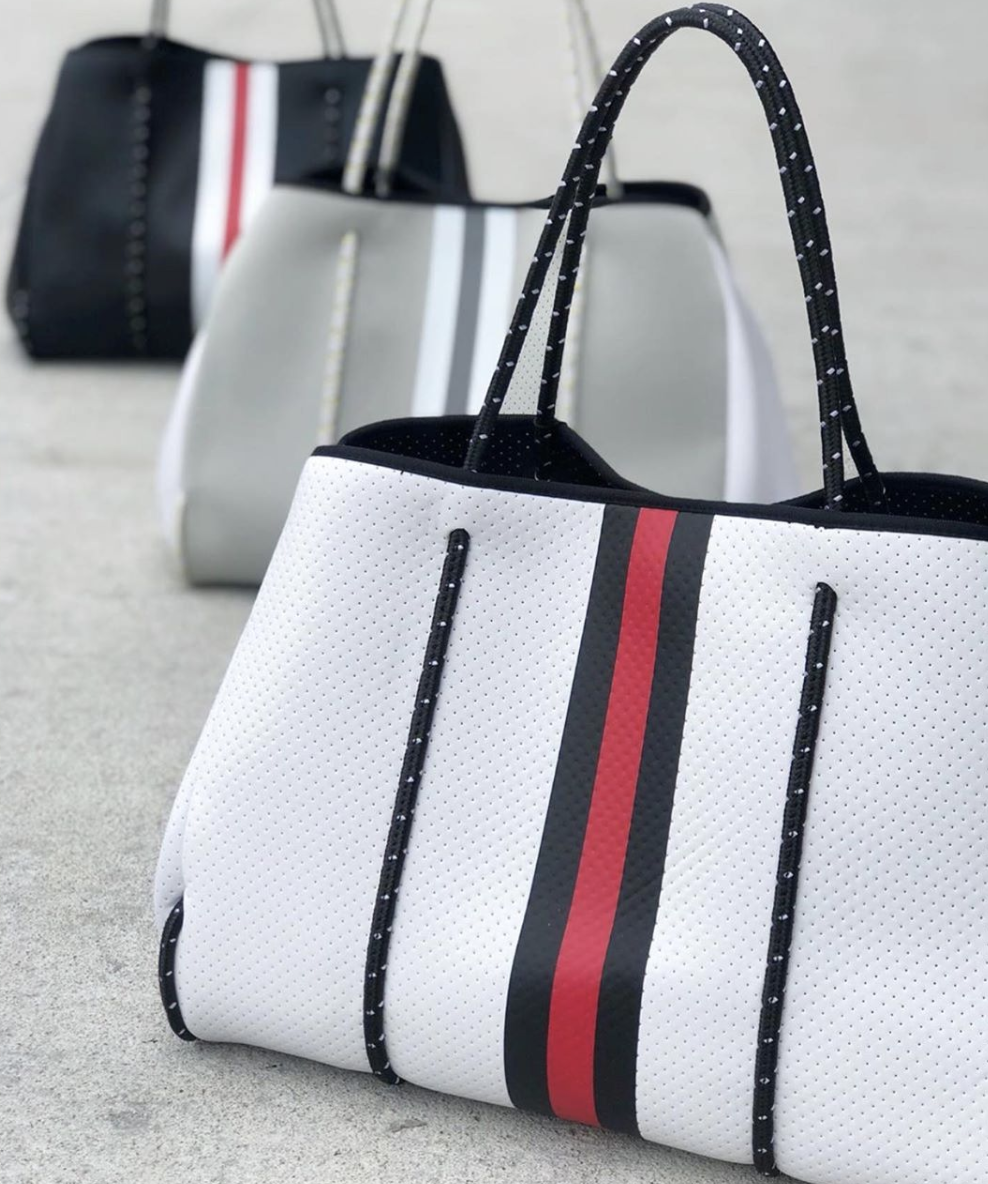 We have found the perfect bag for literally EVERYTHING.  The Greyson Tote  from Haute Shore makes for a great and casual everyday purse, perfect pool bag, or your next favorite travel accessory! We love how there are so many different colors and patterns that are sure to fit anyone's personality!