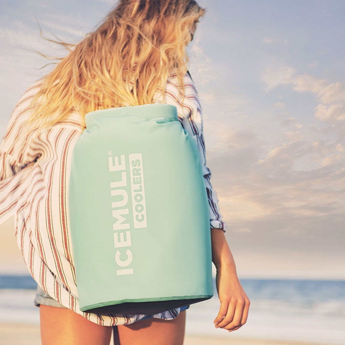 Love drinking an ice cold beer on the beach but hate lugging a cooler down there? We get it! Luckily though, the  IceMule  backpack cooler is so light and easy to carry. Between our crazy wedding schedule we have found time to squeeze in a beach trip, and we never forget to bring this cooler along!