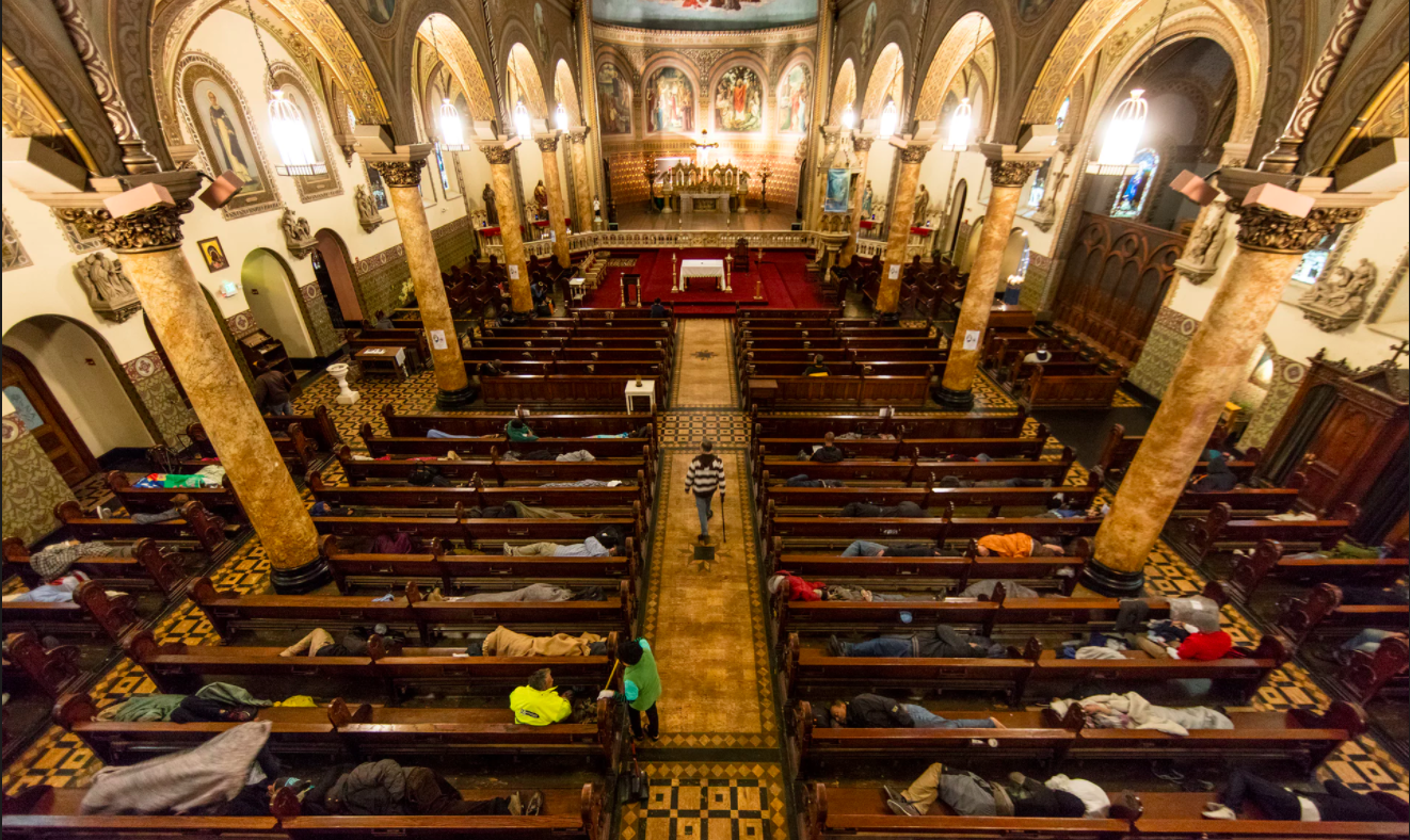 Homeless people sleep in the pews at St Boniface Catholic Church as part of the Gubbio Project  Photograph: David Levene for the Guardian