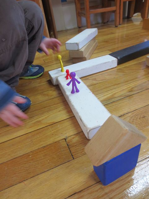 I noted that there was a change in the way the children created landmarks, both on paper and in their constructions. In this photo, you can see that the landmark: School is standing upright and also the children-figures are walking ON the path rather than alongside. This is a marked change in approach.