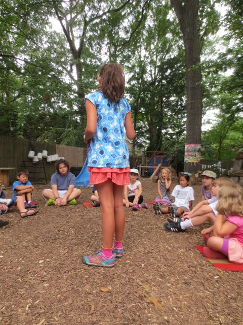 "It's her turn now. One of the Tink campers teaches the other children how to play a game she knows called ""All my friends and all my neighbors"""