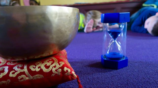 The singing bowl and the five-minute timer. Heart, hand, settle. Breathe.
