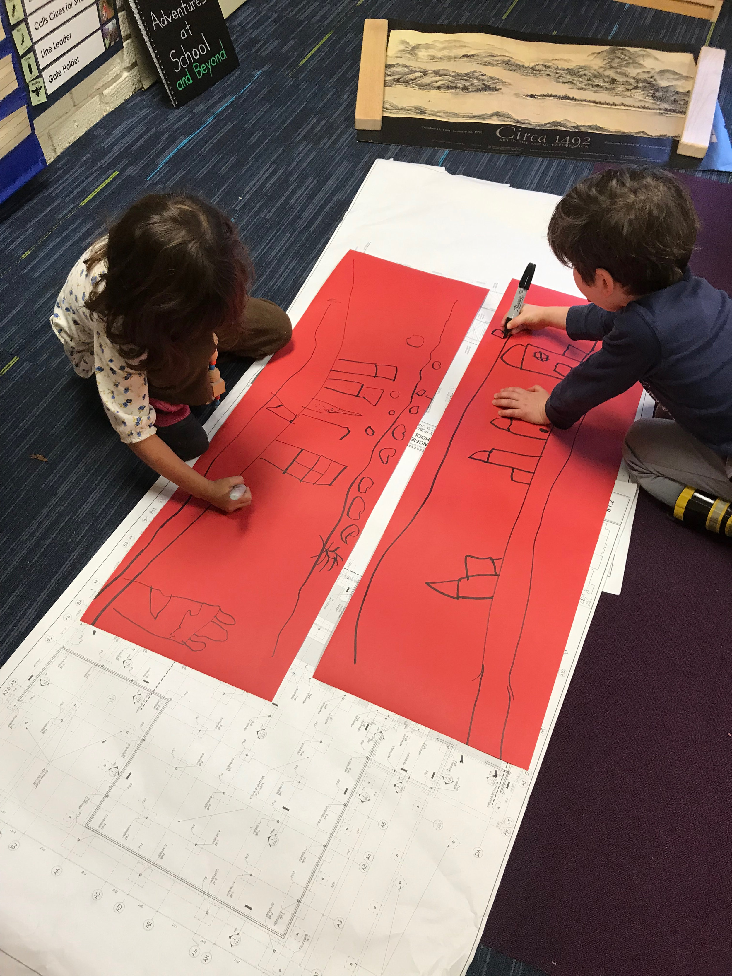 A drawing prompt. Using art prints for inspiration to explore the idea of landscapes, the children were asked to draw where they live. Working in pairs, there was collaboration. They talked as they drew, their lines and ideas mirroring and diverging from the other's drawing.