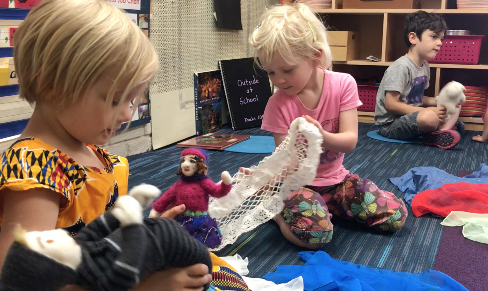 Imagining a world and telling its story using felted dolls, scarves, and doilies.
