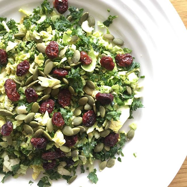 Kale and Brussels Sprout slaw // I love this slaw because you can make it in big batches as the salad doesn't wilt. The dressing is refined sugar and oil free but has a lot of depth and flavour. It's also quick and easy to make and good for a few days.  De-stem your raw kale and chop the stem off your raw Brussels sprouts. Throw them in the food processor and pulse while scraping down the sides. I used one bunch of kale and approximately 20 Brussels sprouts.  For the dressing:  3T dijon mustard  3T honey or maple syrup to make it vegan, both ways are delicious  1.5T apple cider vinegar S&P squeeze of lemon  dash of cayenne 1/2 clove garlic Mix all the ingredients together in a bowl or food processor.  Toast pine nuts, pepitas or almond slivers for crunch and add cranberries for sweet. Toss it all together for a delicious and filling salad. Add some Parmesan, or don't #healthfoodsnob