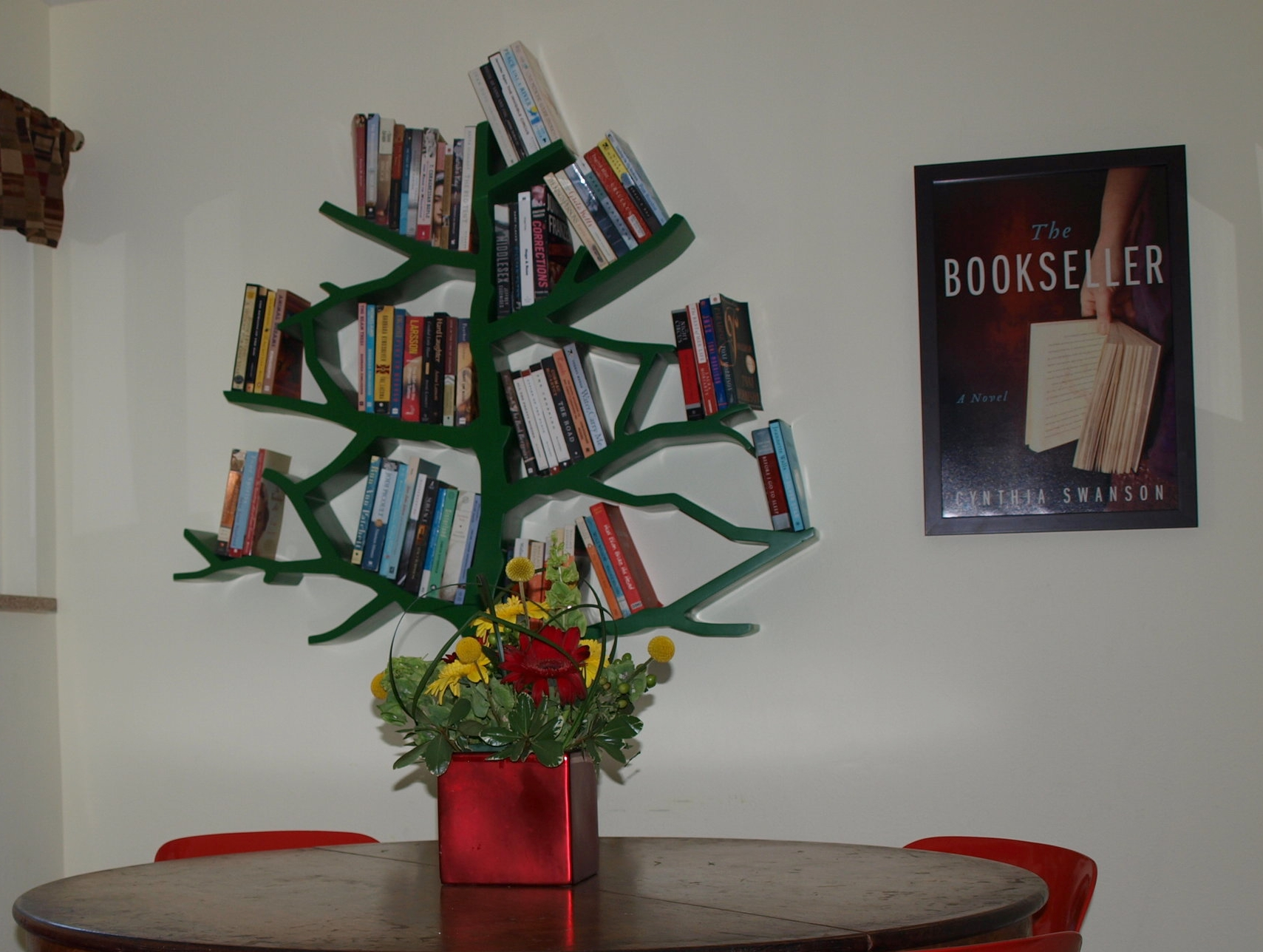 I'm madly in love with this tree-shaped bookshelf from NurseryWorks. It looks great in the library, next to a poster of the cover of my novel The Bookseller.