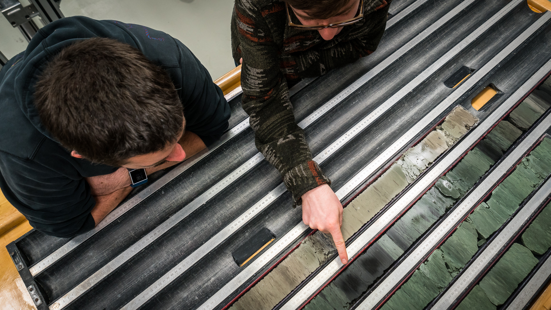 Scientists discuss different climatic events that can be 'read' in the core samples. Through time sediments are deposited on the seafloor building up layers that trained scientists can read like a book.