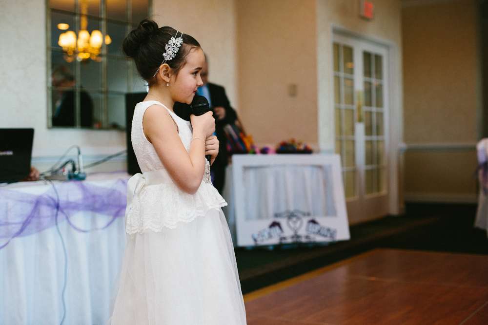 Their daughter, who is beyond adorable, surprised everyone by singing the lyrics to the song for their first dance. She did a great job! More than a few tears were shed.