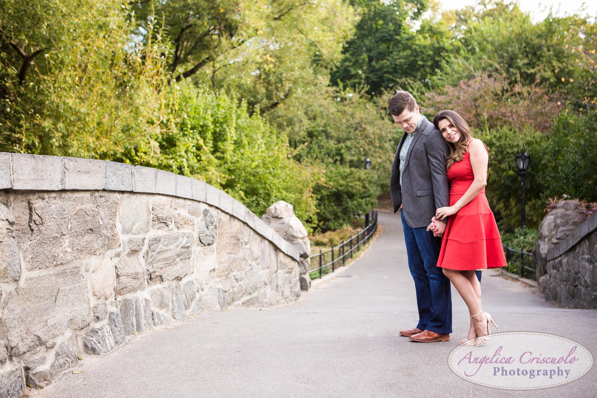 NYC Gapstow Bridge Engagement Photos Central Park Home Alone Red Dress