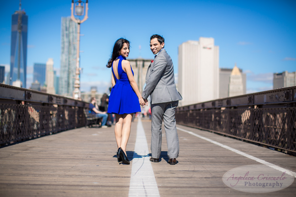Brooklyn Bridge engagement photos in DUMBO fun