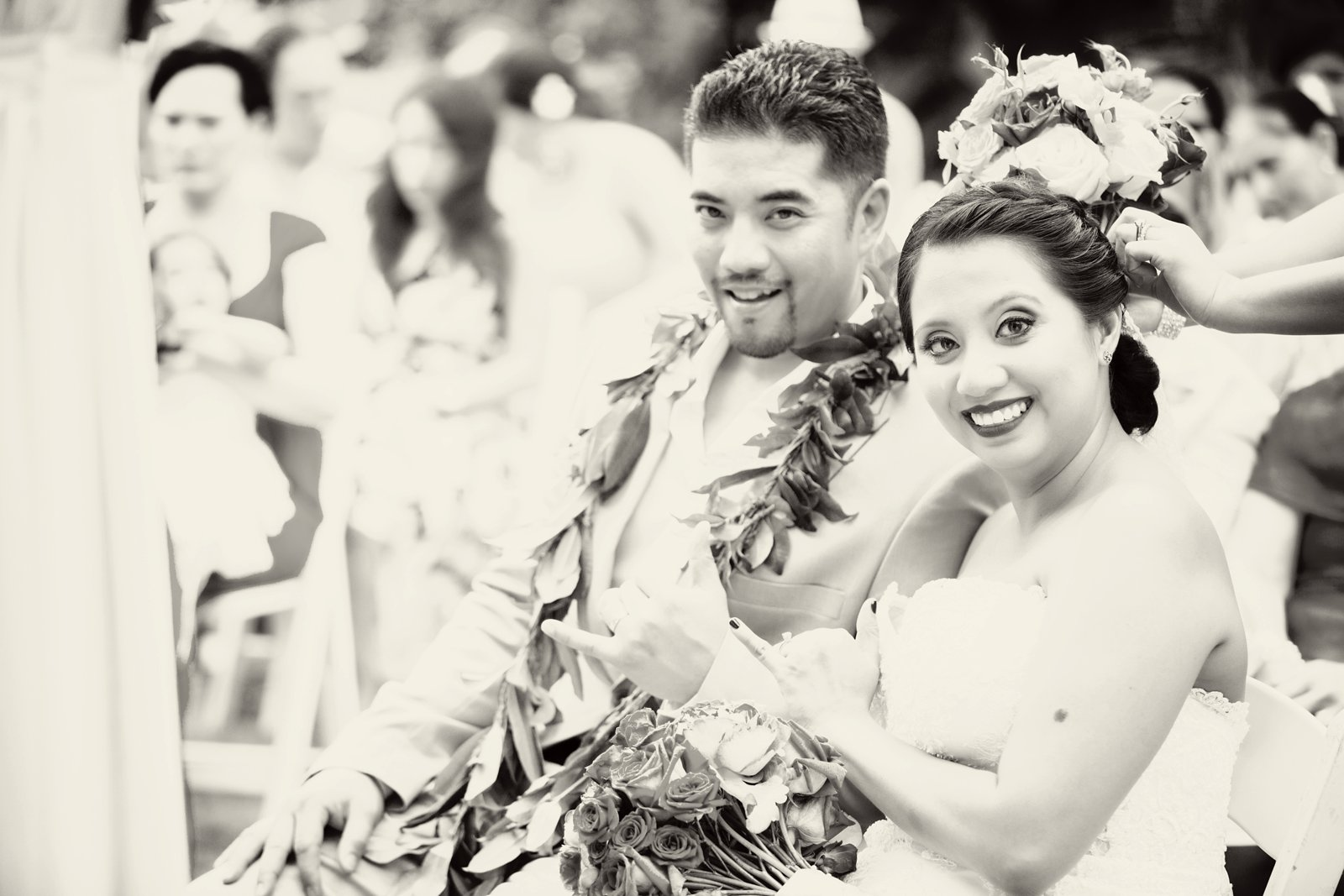 Oahu Hawaii Destination Wedding Photos Bride and Groom hang ten