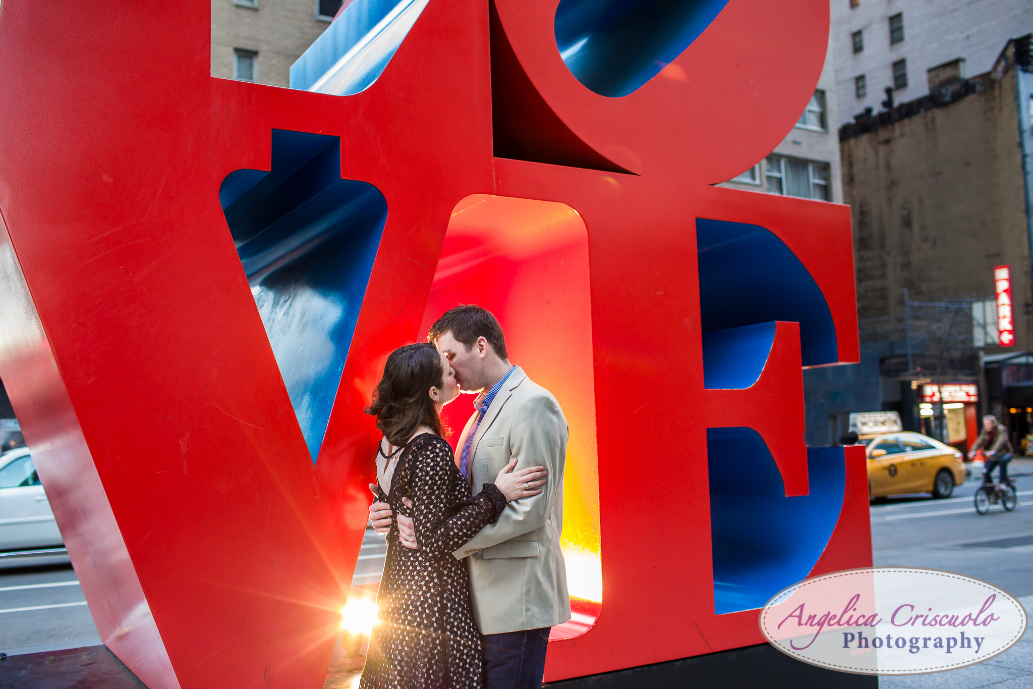 NYC Wedding Engagement photos ideas by the LOVE sign on Avenue of the Americas