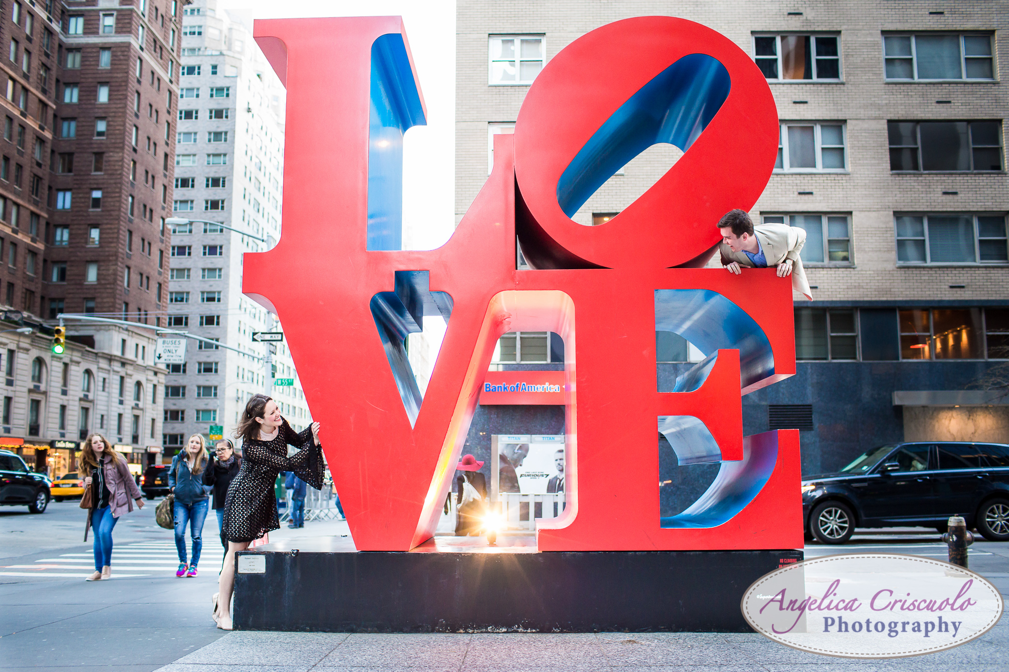 NYC Wedding Engagement photos ideas by the LOVE sign on Avenue of the America