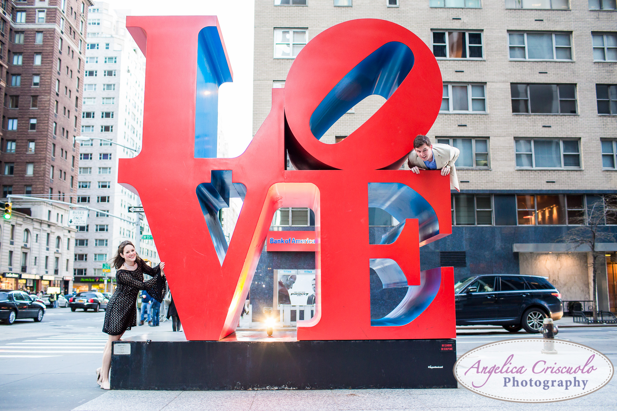 New York DC Wedding Engagement photos ideas by the LOVE sign on Avenue of the Americas