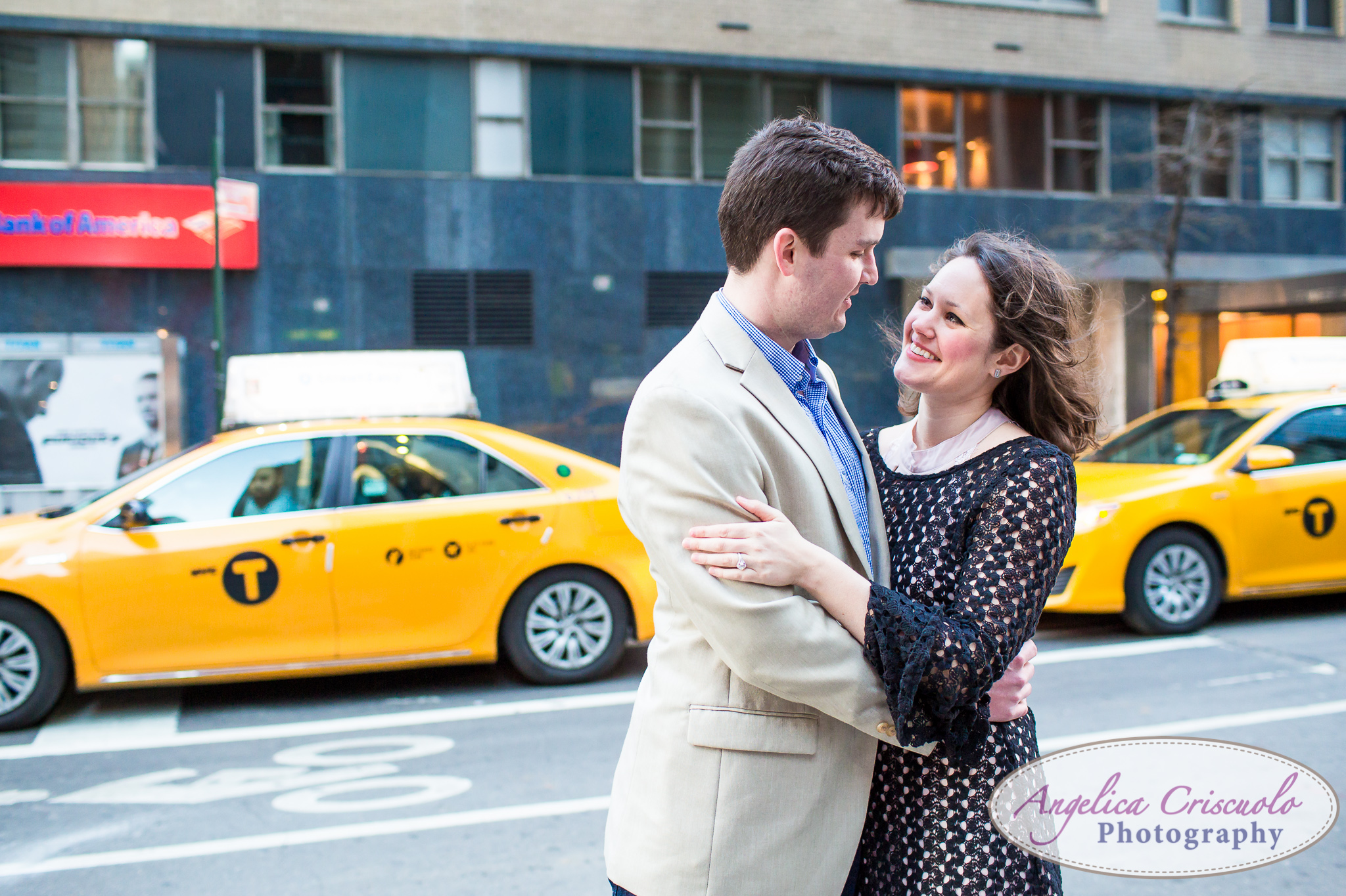DC Couple in NYC NYC Wedding Engagement photos ideas by the LOVE sign on Avenue of the Americas