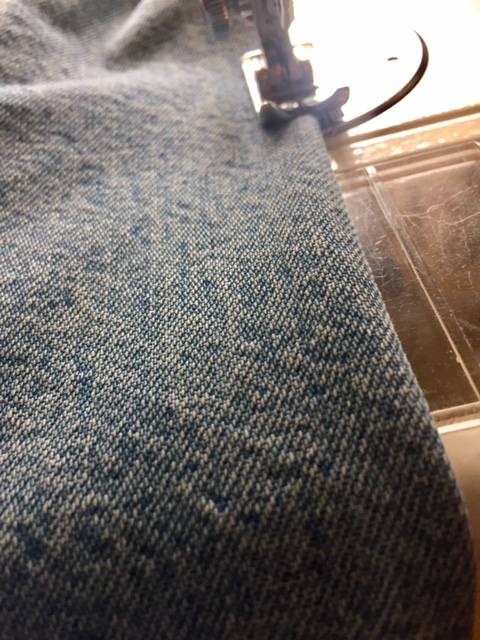 Place the folded jean leg under the sewing machine, allowing a small seam allowance go 3mm and sew straight down the fold.