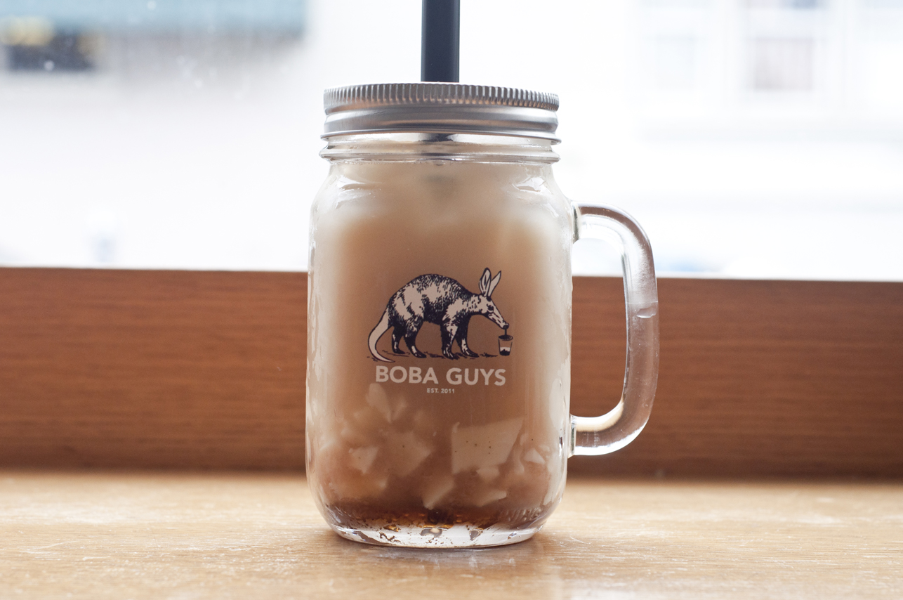 Jasmine milk tea with almond jelly in their signature mason jar mug.