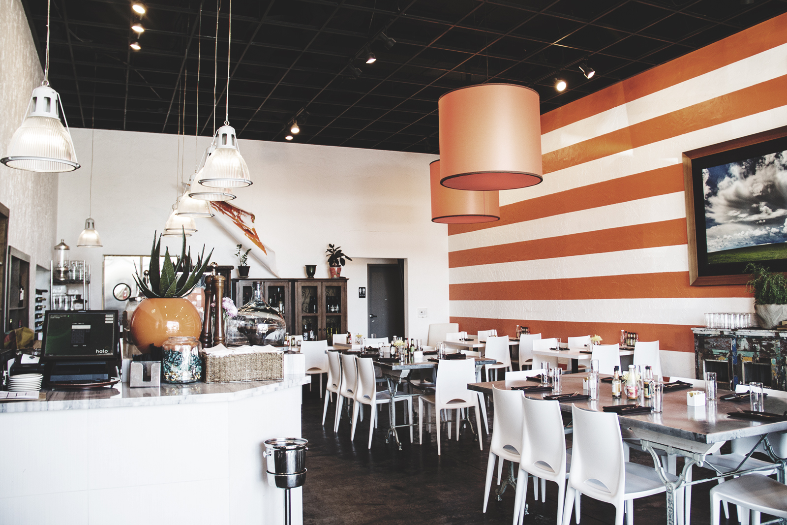 The second dining room at DW Bistro boasts a bold orange motif and an open, airy feel.