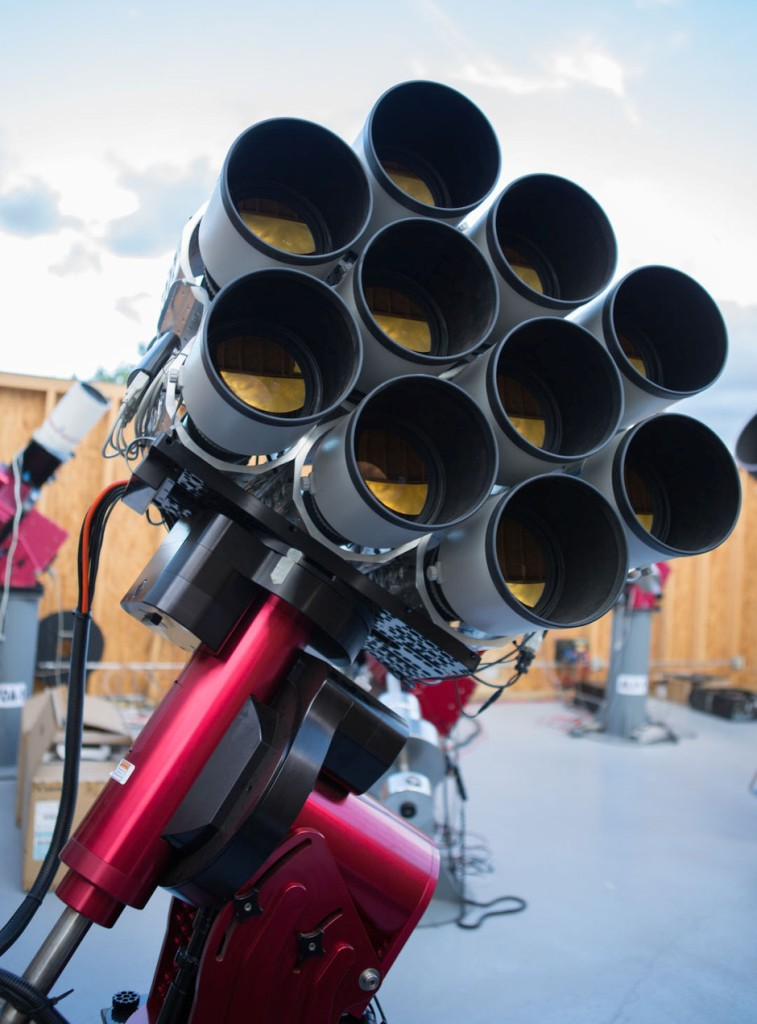 """The Dragonfly Telephoto Array, a robotic imaging system optimized for the detection of extended ultra-low surface brightness structure. The ten Canon 400mm lenses are mounted on a common framework and are co-aligned to image simultaneously the same position on the sky, enabling removal of unwanted scattered light to reveal extremely faint galaxy structure that eludes even the largest, most advanced telescopes today. The Dragonfly """"compound eye"""" is 10 times more sensitive and 1,000 times cheaper than the best large telescopes, and has already made a big new discovery about the structure of the universe. (Image Credit:  University of Toronto/Yale University )."""