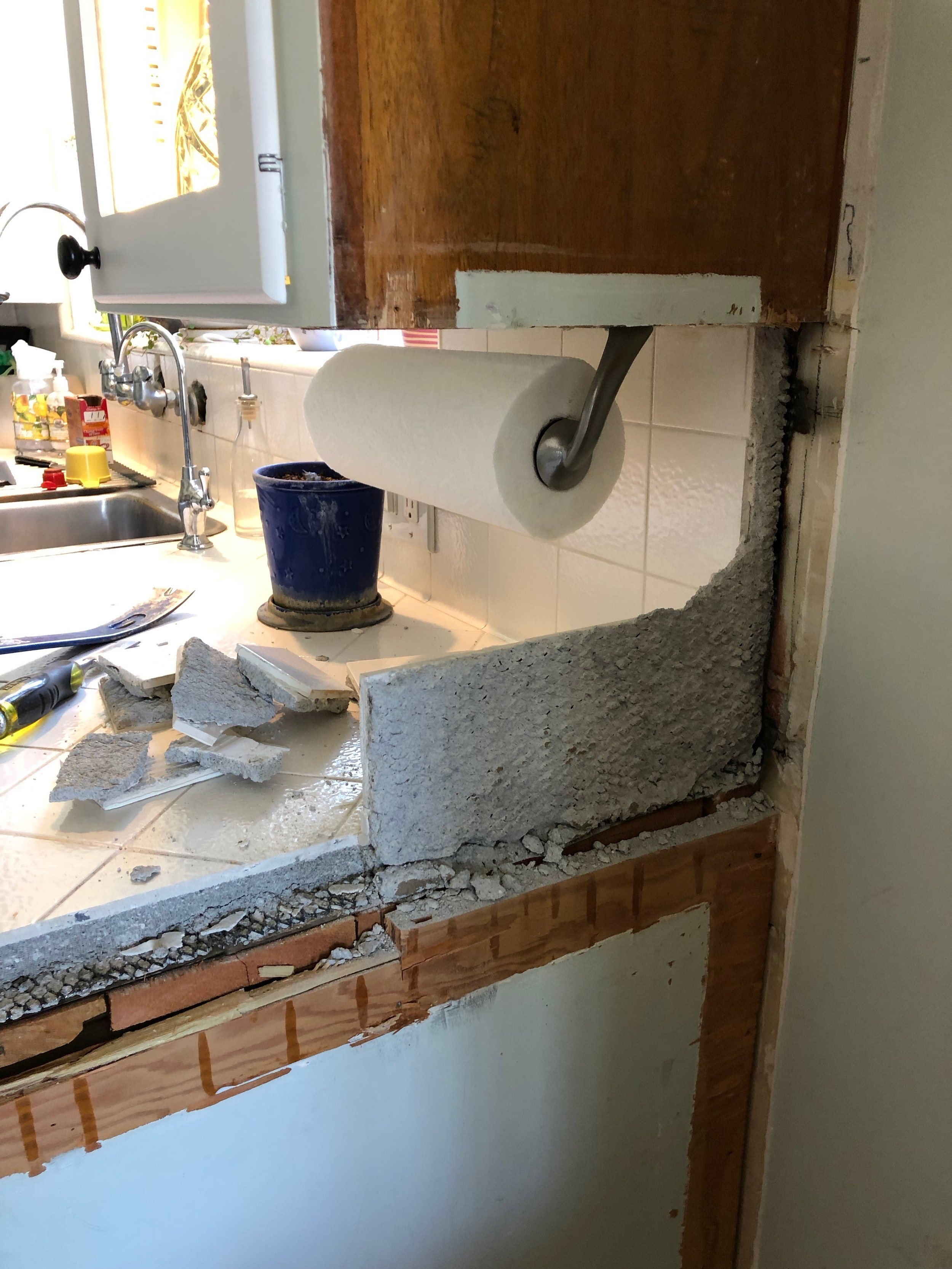 Removing the backsplash for extension of counter tops.