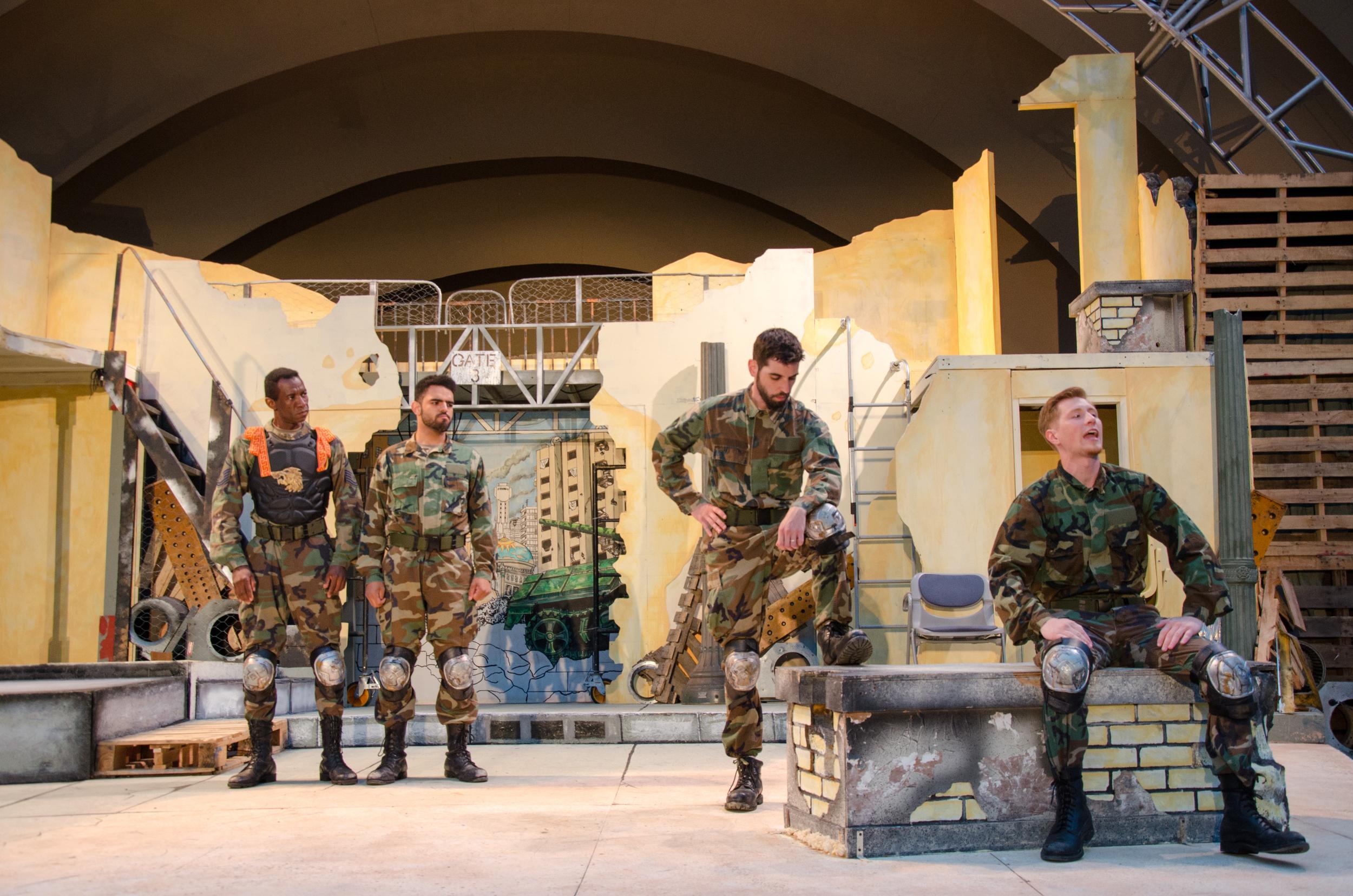 Priam (Clem Onukwubiri), Paris (Matthew Mercado), Hector (Sean Adams), Troilus (Jared Calhoun)